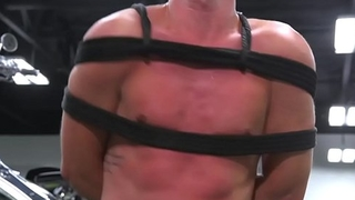 Tiedup stud getting flogged by dominant hunk