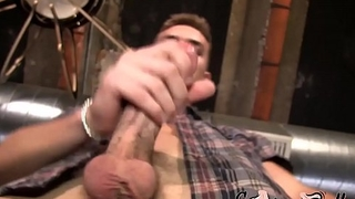 Good looking gay Atlas tugs his oiled big cock and testicles