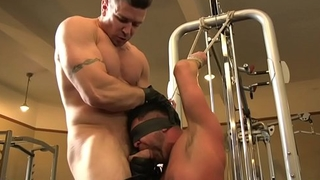 Blindfolded BDSM stud deepthroating gym hunk