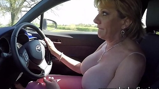 Mature pretty good Lady Sonia plays with her tits while driving